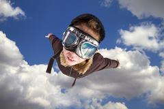 boy flying, daydreaming he´s a pilot - stock photo