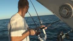Fisherman prepares fishing lane for trolling 2 - stock footage