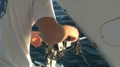 Fisherman prepares downrigger 2 Stock Footage