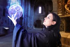 Young beautiful girl with energy sphere, sorcerer Stock Photos