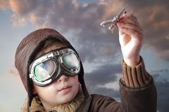 playing to be a professional pilot at sunset - stock photo