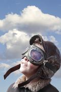 boy dressed up in pilot´s outfit, jacket, hat and glasses. - stock photo