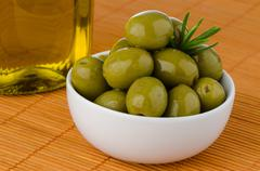 Stock Photo of green olives in a white ceramic bowl