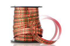 Spool with decorative red ribbon Stock Photos