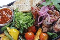 grill meat fried with vegetables and sauce - stock photo