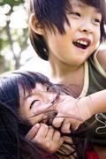sibling playing - stock photo