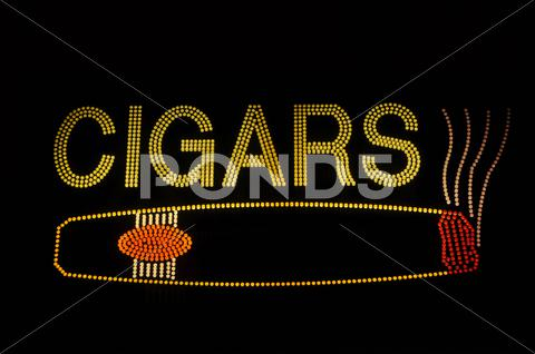 Stock photo of cigar neon sign with icon