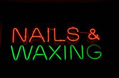 Nails and waxing neon sign Stock Illustration