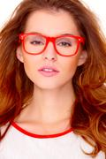 Portrait of young woman wearing glasses on white Stock Photos