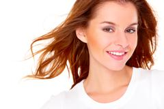 portrait of cute young woman over white - stock photo