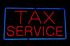 Stock Photo of tax service red neon sign