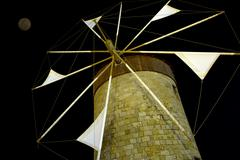 Windmil at night, Rhodes, Greece Stock Photos