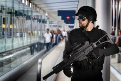 Airport security, armed police Stock Photos