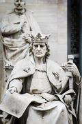 king of stone, sculpture of the king alfonso x wise - stock photo