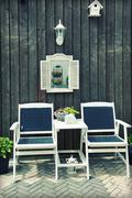wooden chairs by home garden - stock photo