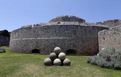 Canon balls, in Rhodes old town moat. Stock Photos