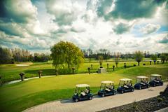 Golf cars Stock Photos