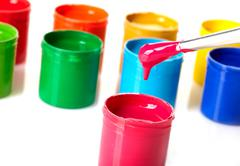 Paint buckets with paintbrush over white background Stock Photos