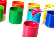 Stock Photo of paint buckets with paintbrush over white background