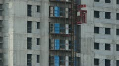 Construction workers in an elevator,close to construction site building. Stock Footage