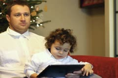 Father and his son with tablet computer pointing of something Stock Footage