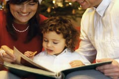 Happy family viewing photos at christmas eve - stock footage