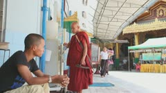 Buddhist monk drink water in Sule Pagoda Stock Footage
