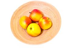 Apples in the wooden bowl Stock Photos