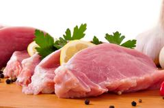 slices of loin with lemon, parslay and garlic - stock photo