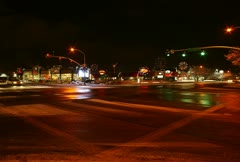 A busy intersection at night Stock Footage