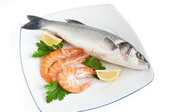 sea bass with parsley and prawns - stock photo