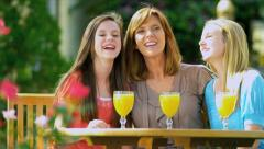 Teenage Girls Laughing with Mom Outside Stock Footage