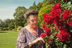 Old woman in garden Stock Photos