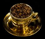 Stock Photo of gold cup with coffee beans