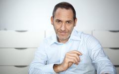 smart businessman smiles on you - stock photo