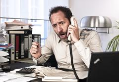 furious businessman on the phone - stock photo