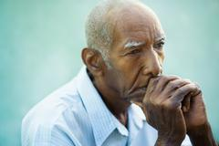 Portrait of sad bald senior man Stock Photos