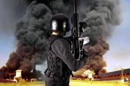 Explosion in an industry, armed police wearing bulletproof vests Stock Photos