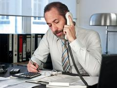 Businessman calculating finance Stock Photos
