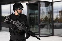Defense companies, armed police wearing bulletproof vests Stock Photos