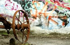 graffiti with rusty tool - stock photo