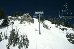 Time lapsed ski lift ride up a snowy mountain Stock Footage