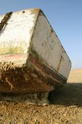 old fisherboat in the desert, paracas, peru - stock photo