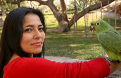 woman with parrot - stock photo