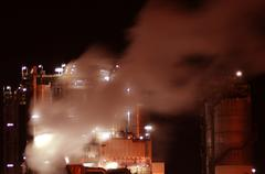 industry with fire at night - stock photo