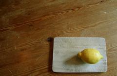 Lemon on table Stock Photos