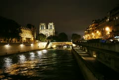 Timelapse of barges moving through a canal in front of the Cathedral Notre Dame Stock Footage