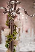 candleholder with ivy and a white rose - stock photo