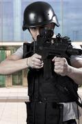 black armed policemen - stock photo