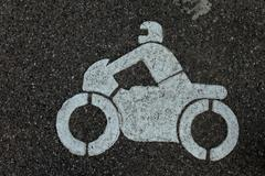 sign on asphalt - stock photo